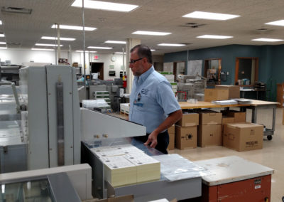 Bindery Tech Kirk busy cutting