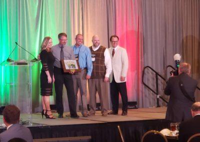 Deseret Mutual Benefit Administrators receiving award
